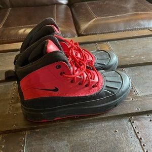 Red and black nike boots